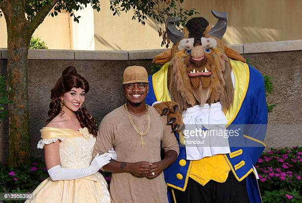 In this handout photo provided by Disney Parks Grammy awardwinning RB artist NeYo poses with Beauty and the Beast while on break from taping ABC's...
