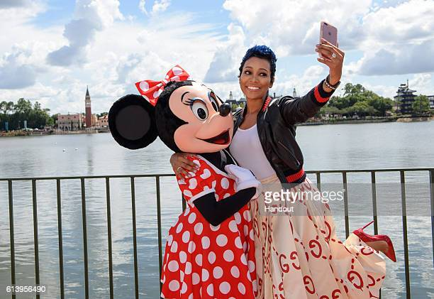 In this handout photo provided by Disney Parks Grammy awardwinning RB artist Monica poses with Minnie Mouse on while on break from taping ABC's...