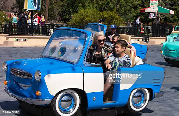 In this handout photo provided by Disney Parks Gwen Stefani and son Kingston Rossdale ride Luigiâs Rollickinâ Roadsters the allnew Cars Land...