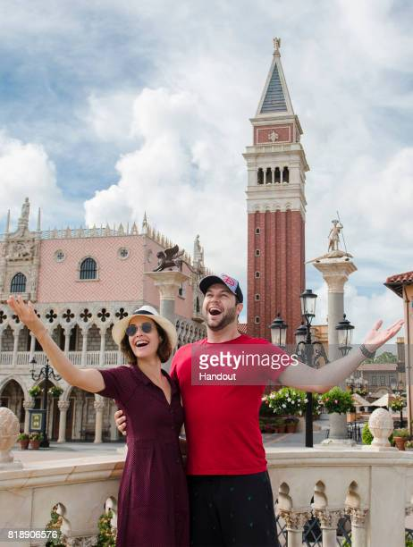 In this handout photo provided by Disney Parks Hollywood couple Cobie Smulders and Taran Killam strike a pose at the Italy pavilion at Epcot on July...