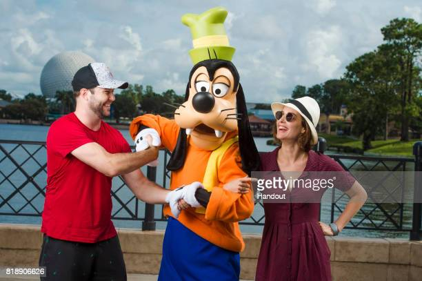 In this handout photo provided by Disney Parks Hollywood couple Taran Killam and Cobie Smulders get silly with their favorite Disney pal Goofy on...