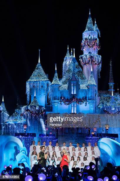 In this handout photo provided by Disney Parks Idina Menzel and Kristen Bell of Frozen perform during a taping of The Wonderful World of Disney...