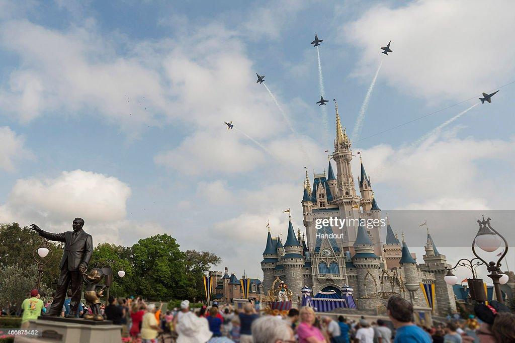 U.S. Navy Blue Angels Soar Above Cinderella Castle At Walt Disney World Resort : News Photo