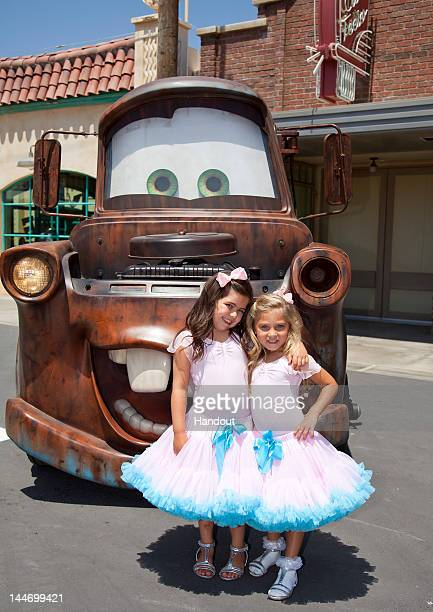 In this handout photo provided by Disney Parks internet sensations Sophia Grace Brownlee and Rosie Grace McClelland tape a segment with Mater of the...