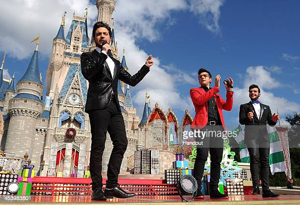 In this handout photo provided by Disney Parks Italian pop vocal trio IL VOLO performs Feliz Navidad while taping the Disney Parks Christmas Day...