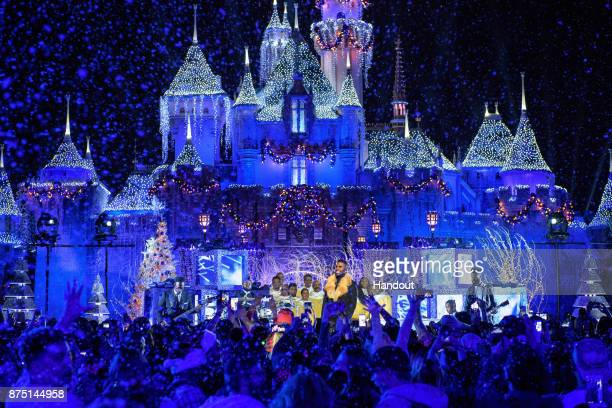 In this handout photo provided by Disney Parks Jason Derulo performs during a taping of 'The Wonderful World of Disney Magical Holiday Celebration'...