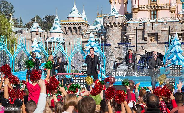 In this handout photo provided by Disney Parks Jerry Becker Patrick Monahan Drew Shoals and Jimmy Stafford of Train perform during the production of...