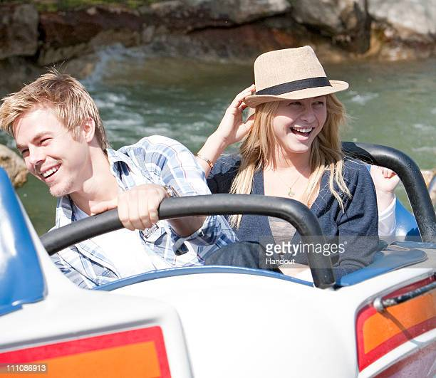 In this handout photo provided by Disney Parks Julianne Hough and Derek Hough ride the Matterhorn Bobsleds on March 29 2011 at Disneyland in Anaheim...