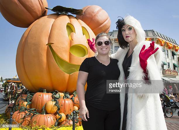 In this handout photo provided by Disney Parks Kelly Clarkson celebrates Halloween Time with Cruella de Vil on September 21 2016 at Disneyland park...