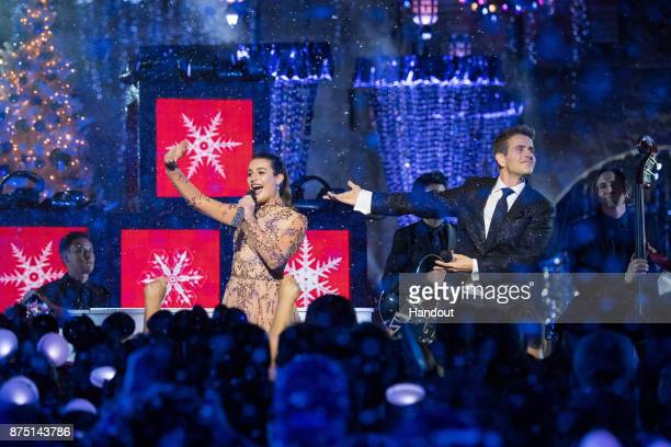 In this handout photo provided by Disney Parks Lea Michele and Joey McIntyre of NKOTB perform 'Baby It's Cold Outside' during a taping of 'The...