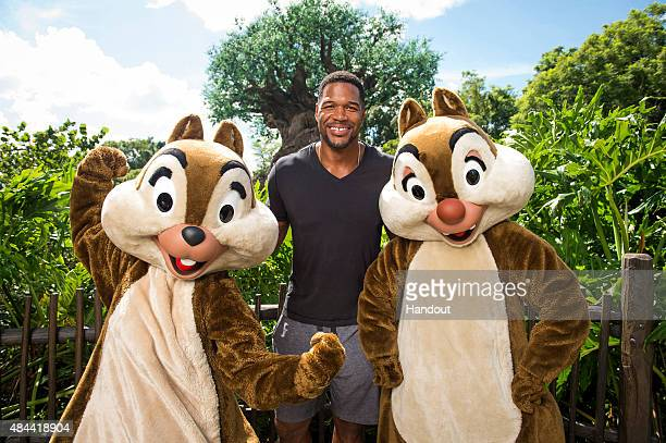 In this handout photo provided by Disney Parks Live with Kelly and Michael cohost Michael Strahan meets up with Chip and Dale at Disney's Animal...