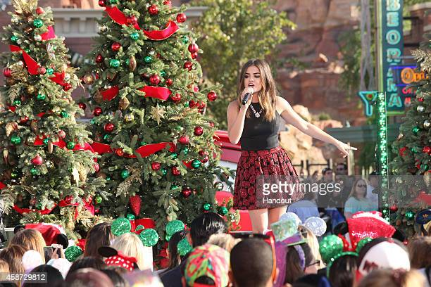 In this handout photo provided by Disney Parks Lucy Hale performs during the production of Disney Parks' Frozen Christmas Celebration at Cars Land at...