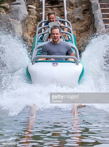 In this handout photo provided by Disney Parks, Matt Damon rides Matterhorn Bobsleds with family and friends August 20, 2015 at Disneyland park in...
