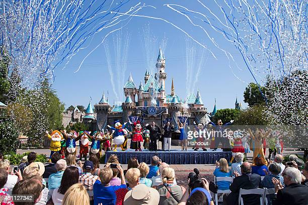 In this handout photo provided by Disney parks, Mickey Mouse and his friends celebrate the 60th anniversary of Disneyland park during a ceremony at...