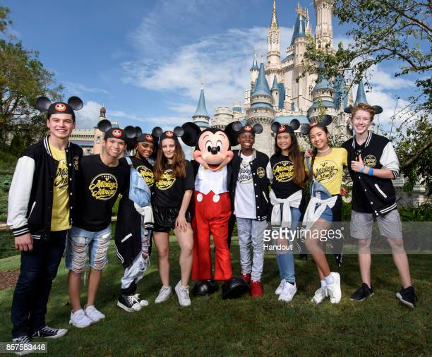 In this handout photo provided by Disney Parks Mickey Mouse welcomes the allnew cast of Disney's reimagined 'Club Mickey Mouse' for their firstever...