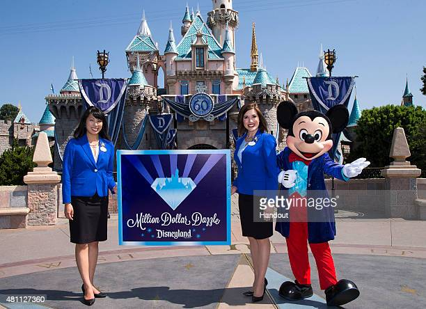 In this handout photo provided by Disney parks, MILLION DOLLAR DAZZLE - Mickey Mouse and the 2015 Disneyland Resort Ambassadors celebrate the...