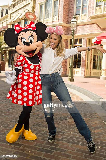 In this handout photo provided by Disney Parks model and actress Christie Brinkley poses with Minnie Mouse at Magic Kingdom park on March 15 2016 in...