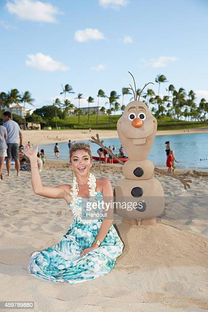 In this handout photo provided by Disney Parks 'Modern Family' star Sarah Hyland is photographed on the beach at at Aulani a Disney Resort Spa during...