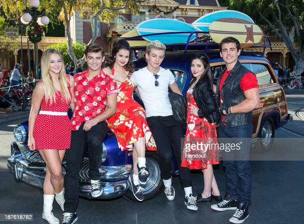 In this handout photo provided by Disney Parks Mollee Gray Garrett Clayton Maia Mitchell Ross Lynch Grace Phipps and John DeLuca of the hit Disney...
