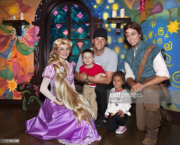 In this handout photo provided by Disney Parks New England Patriots Quarterback Tom Brady his son Jack and niece Jordan meet Rapunzel and Flynn Rider...