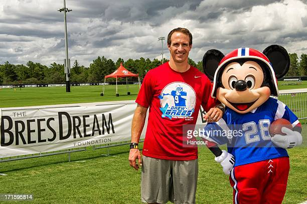 In this handout photo provided by Disney Parks New Orleans Saints AllPro quarterback Drew Brees poses with Mickey Mouse at ESPN Wide World of Sports...
