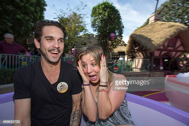 In this handout photo provided by Disney Parks newlyweds tennis professional Ryan Sweeting and actress Kaley Cuoco Sweeting take a ride on The Mad...