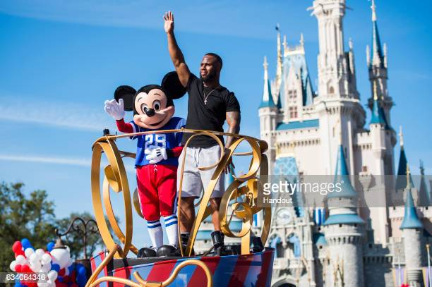 In this handout photo provided by Disney Parks NFL Super Bowl star running back James White participates in the 'Going to Disney World' celebration...
