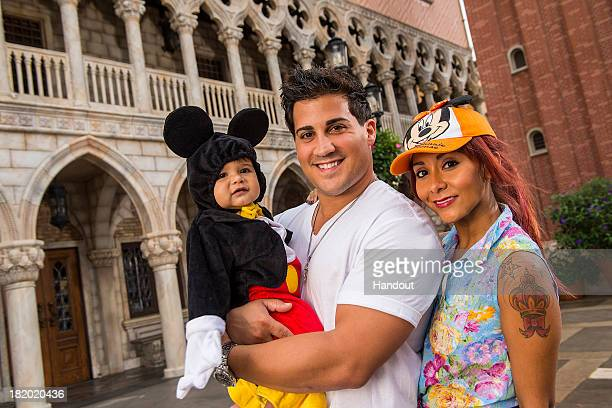 In this handout photo provided by Disney Parks Nicole 'Snooki' Polizzi poses with fiance Jionni LaValle and oneyearold son Lorenzo inside the Italy...