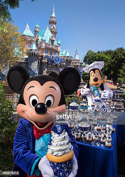 In this handout photo provided by Disney Parks on the eve of the 60th anniversary of the Disneyland Resort Mickey Mouse and Goofy help prepare...