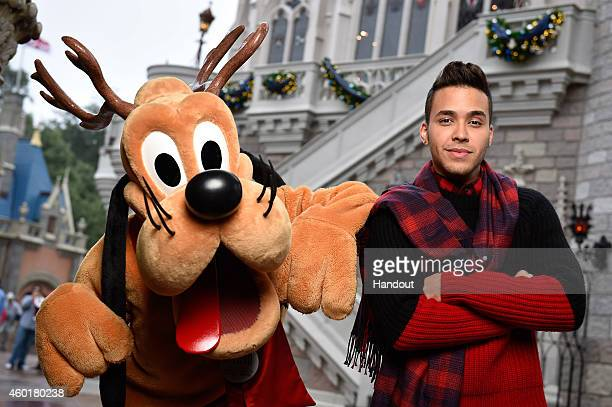 In this handout photo provided by Disney Parks Prince Royce and Reindeer Pluto attend the taping of the Disney Parks 'Frozen Christmas Celebration'...