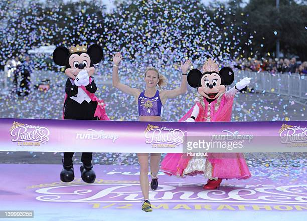 In this handout photo provided by Disney Parks Rachel Booth of Mandeville Louisiana crosses the finish line to capture the 2012 Disney's Princess...