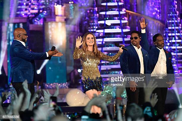 In this handout photo provided by Disney Parks RB group Boyz II Men Wanya Morris Nathan Morris and Shawn Stockman perform with singer JoJo during the...