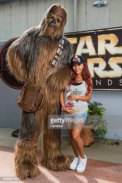 In this handout photo provided by Disney Parks reality TV celebrity Nicole 'Snooki' Polizzi poses with Chewbacca the famous Wookiee from 'Star Wars'...