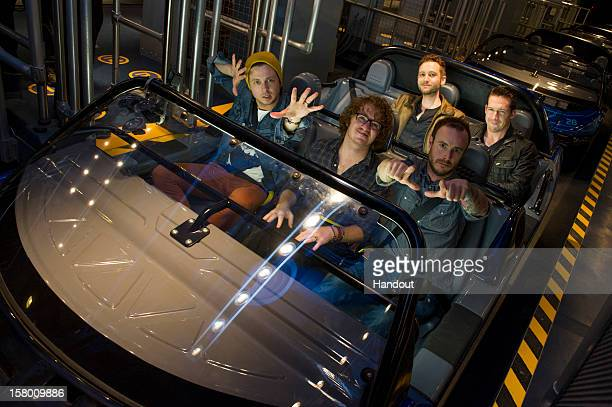 In this handout photo provided by Disney Parks Ryan Tedder Drew Brown and Eddie Fisher Brent Kutzle and Zach Filkins of OneRepublic take a ride...