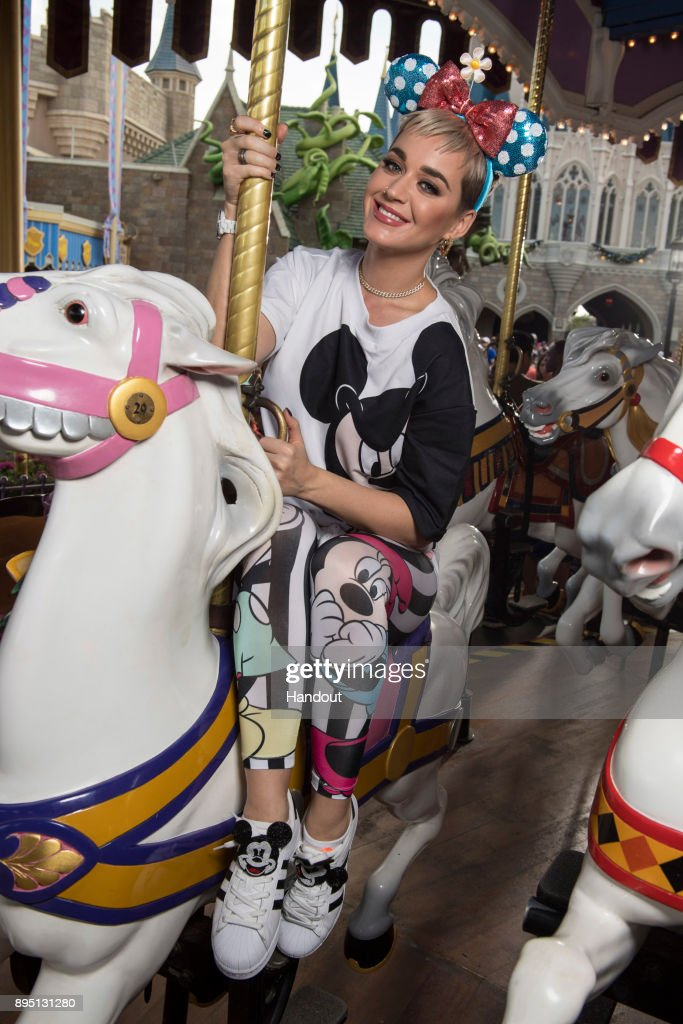 In this handout photo provided by Disney Parks, singer Katy Perry takes a ride on The Prince Charming Regal Carousel at the Magic Kingdom Park on December 18, 2017 at Walt Disney World Resort in Lake Buena Vista, Florida.