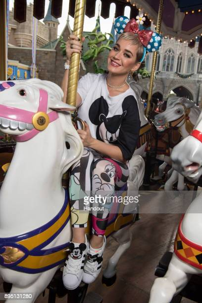 In this handout photo provided by Disney Parks singer Katy Perry takes a ride on The Prince Charming Regal Carousel at the Magic Kingdom Park on...