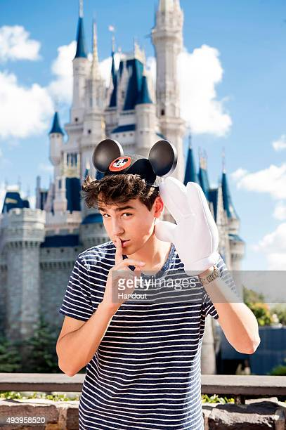 In this handout photo provided by Disney Parks singer/songwriter Jacob Whitesides poses in front of Cinderella's Castle in the Magic Kingdom at Walt...