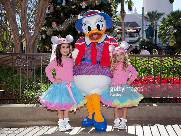 In this handout photo provided by Disney Parks Sophia Grace Brownlee and Rosie McClelland pose with Daisy Duck while taping segments for the 2012...