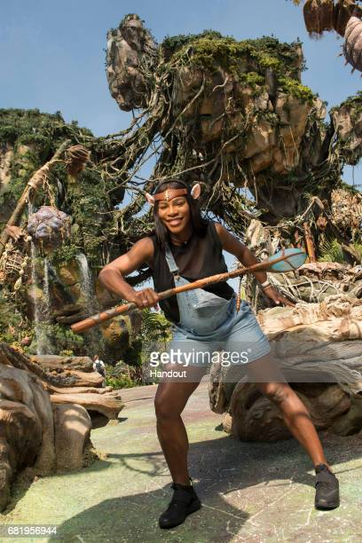 In this handout photo provided by Disney Parks Tennis superstar Serena Williams channels her inner Na'vi during a sneak peek at Pandora The World of...