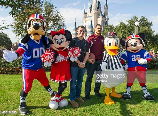 In this handout photo provided by Disney Parks, Texas A&M quarterback Johnny Manziel and Texas A&M wide receiver Mike Evans pose with Disney...