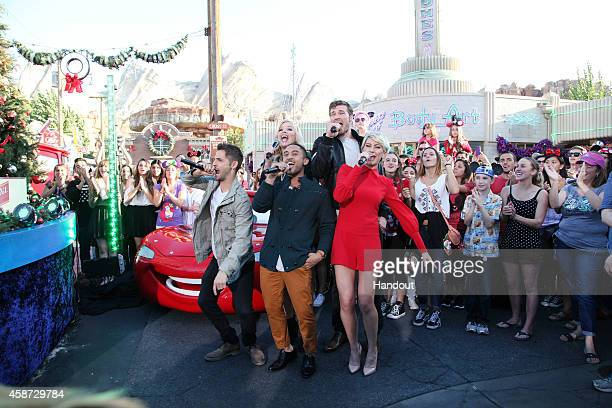 In this handout photo provided by Disney Parks The cast of ABC Family's Baby Daddy JeanLuc Bilodeau Melissa Peterman Tahj Mowry Derek Theler and...
