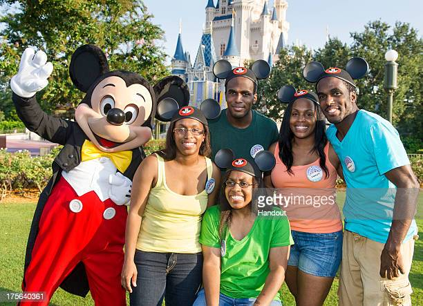 In this handout photo provided by Disney Parks the Gaither Quintuplets from Indianapolis Ind celebrated their 30th birthdays with Mickey Mouse in the...
