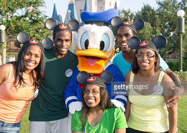 In this handout photo provided by Disney Parks the Gaither Quintuplets from Indianapolis Ind celebrated their 30th birthdays with Donald Duck in the...