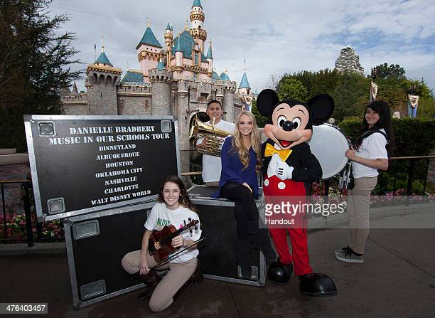 In this handout photo provided by Disney Parks The winner of season four of 'The Voice' Danielle Bradbery poses with students Wendy Holloway Anthony...