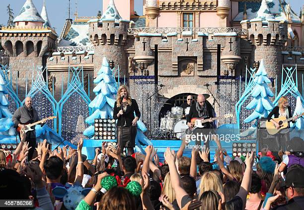 In this handout photo provided by Disney Parks Trisha Yearwood performs during the production of Disney Parks' Frozen Christmas Celebration at...