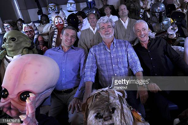 In this handout photo provided by Disney Parks Walt Disney Company President and CEO Bob Iger 'Star Wars' creator George Lucas and actor Anthony...