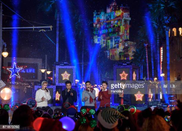 In this handout photo provided by Disney Parks Winner of ABC's 'Boy Band' band In Real Life performs during a taping of Disney Parks Presents a...