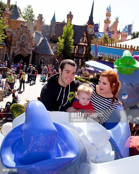 In this handout photo provided by Disney Pete Wentz Ashlee Simpson and their son 11 month old Bronx Mowgli Wentz ride Dumbo Flying Elephants at...