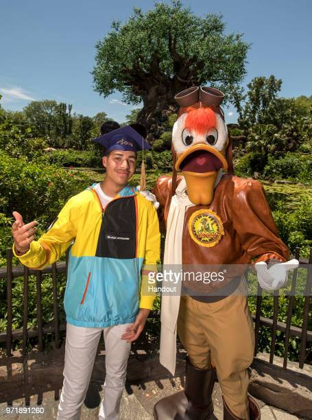 In this handout photo provided by Disney Resorts actor Marcus Scribner poses with Launchpad McQuack at Disneys Animal Kingdom as he celebrates his...