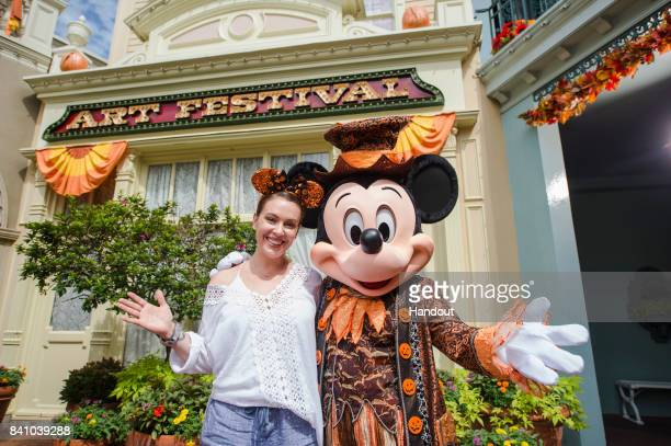 In this handout photo provided by Disney Resorts actress Alyssa Milano visits the Magic Kingdom Park at Walt Disney World on August 29 2017 in Lake...